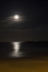 full moon over sandy beach