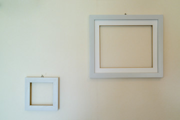 Empty wooden picture frames mounted on the wall