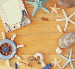collection of nautical and beach objects creating a frame over w