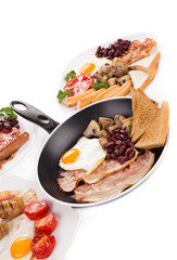 Fried egg with bacon in a frying pan.