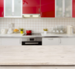 Wooden table on red modern kitchen bench interior background