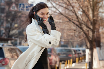 businesswoman talking on the phone over city background