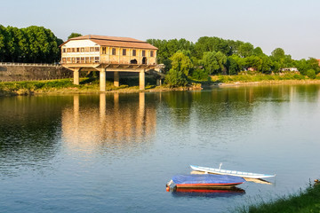 Old ruined seaplane base on the shore of river Ticino