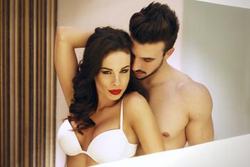 Sexy passionate couple in mirror