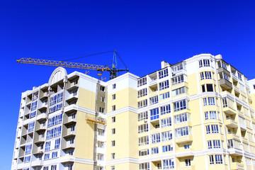 construction of multistorey modern house with hoisting crane
