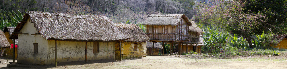 Typical malgasy village - african hut, poverty in madagascar