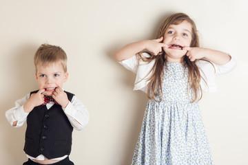 siblings making faces