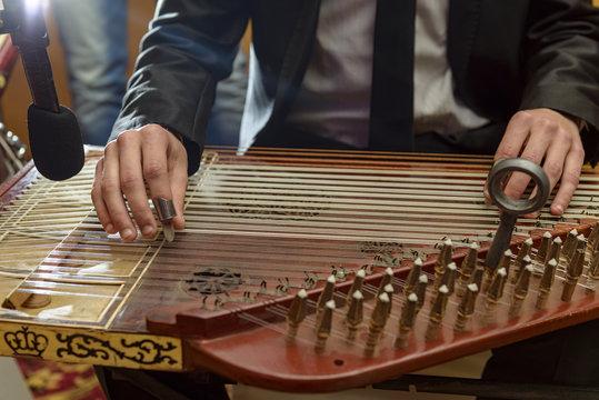 Male Hands Playing Arabian Qanun Musical Instrument