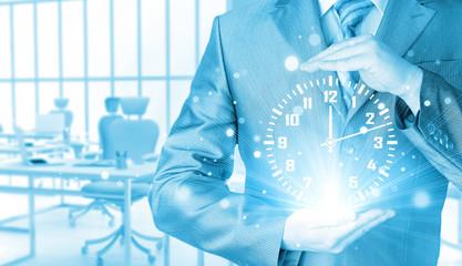 Image of businessman holding clock against illustration