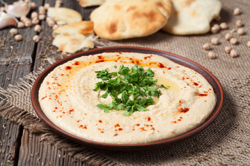 Delicious hummus creamy eastern food in bowl with pita