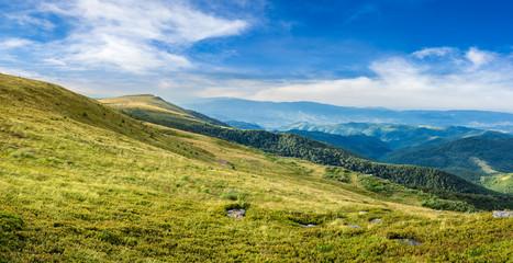 valley on hillside of mountain range