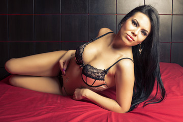 Sensual brunette woman with long hair posing in sexy lingerie  i