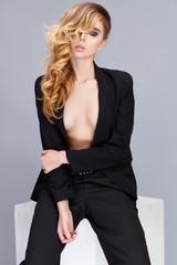 Beautiful young woman wearing black suit