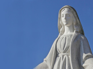 Virgin Mary on the blue background of sky