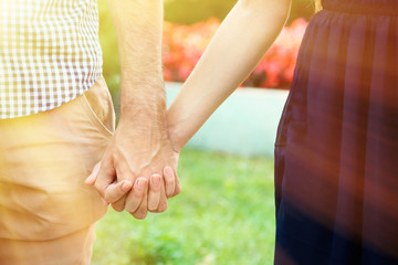Loving couple holding hands outdoors