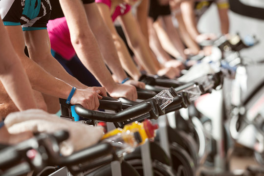 gym detail shot - people cycling, spinning class