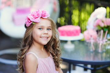 Little girl celebrate Happy Birthday Party with rose decor