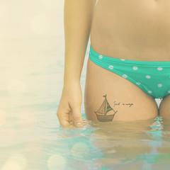 Ship tattoo on a hip of traveler