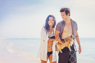 couple with a dog on a beach
