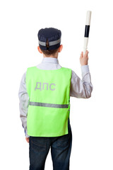 The back of young boy dressed as road policeman with staff