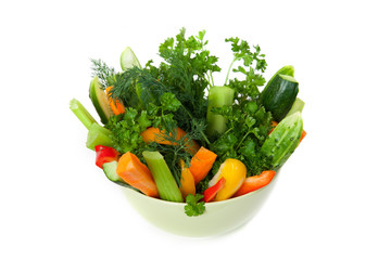 The plate of cuttted vegetables in green bowl