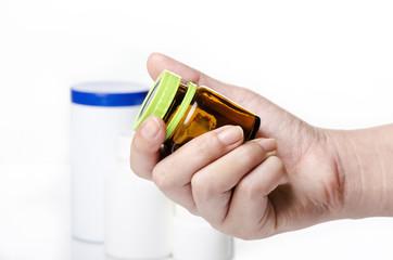 holding a medicine bottle