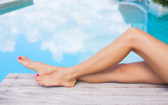 Beautiful women legs by the pool