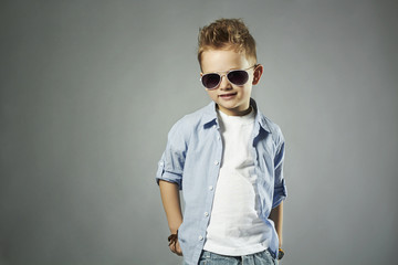 fashionable little boy in sunglasses.stylish child in jeans