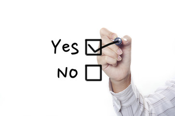 a business person drawing yes and no check box