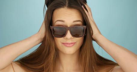 Cute vivacious woman in sunglasses