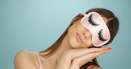 Fun woman relaxing in a sleep mask