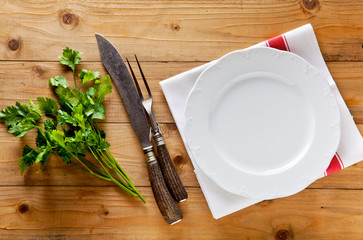 empty plate and carving knife and fork