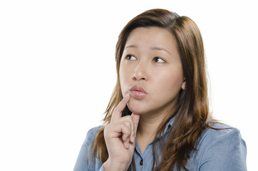 Young woman thinking against white background