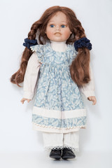 Vintage porcelain doll girl with long braids brown hair