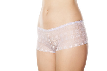 front view of a pretty woman's hips in white lace panties