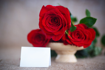 beautiful bouquet of red roses on an old table of burlap