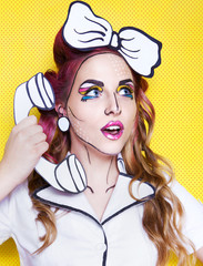 Woman with cartoon pop art make up and phone