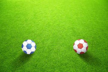 Artificial green grass with blue and red balls