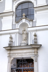 Statue of Virgin Mary. Decoration element of house in old city.