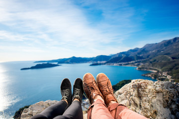 Couples legs on the mountain