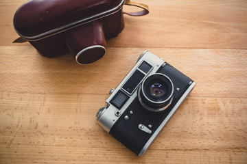 Toned photo of retro manual camera from top view point