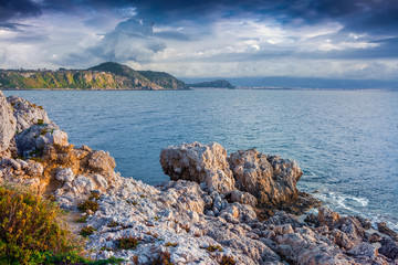 Dramatic spring sunset on the cape Milazzo