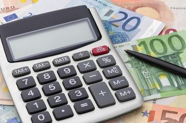 Fotomurales - Taschenrechner mit Geldscheinen