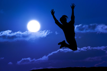 Happy girl woman jump against beautiful sunset. Freedom