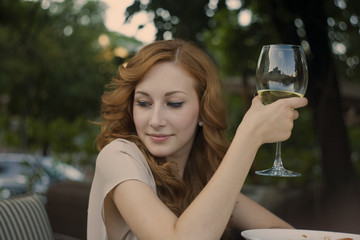 young girl drinking wine