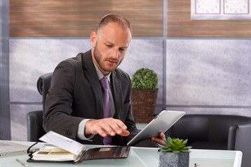 Businessman with tablet and personal organizer