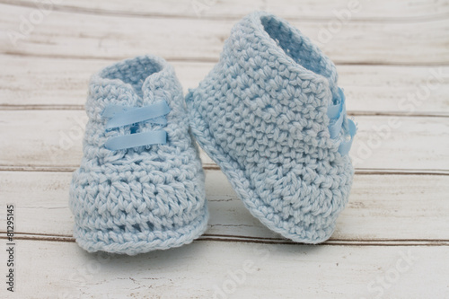 0e432fc090b8 Pale Blue Baby Booties on wood background