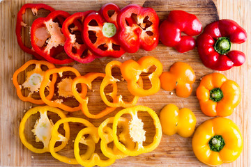 Sliced Red and Yellow Bell Peppers on Wooden Board