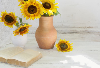 Still life with sunflowers and book