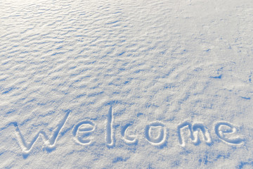 word welcome written on the snow surface